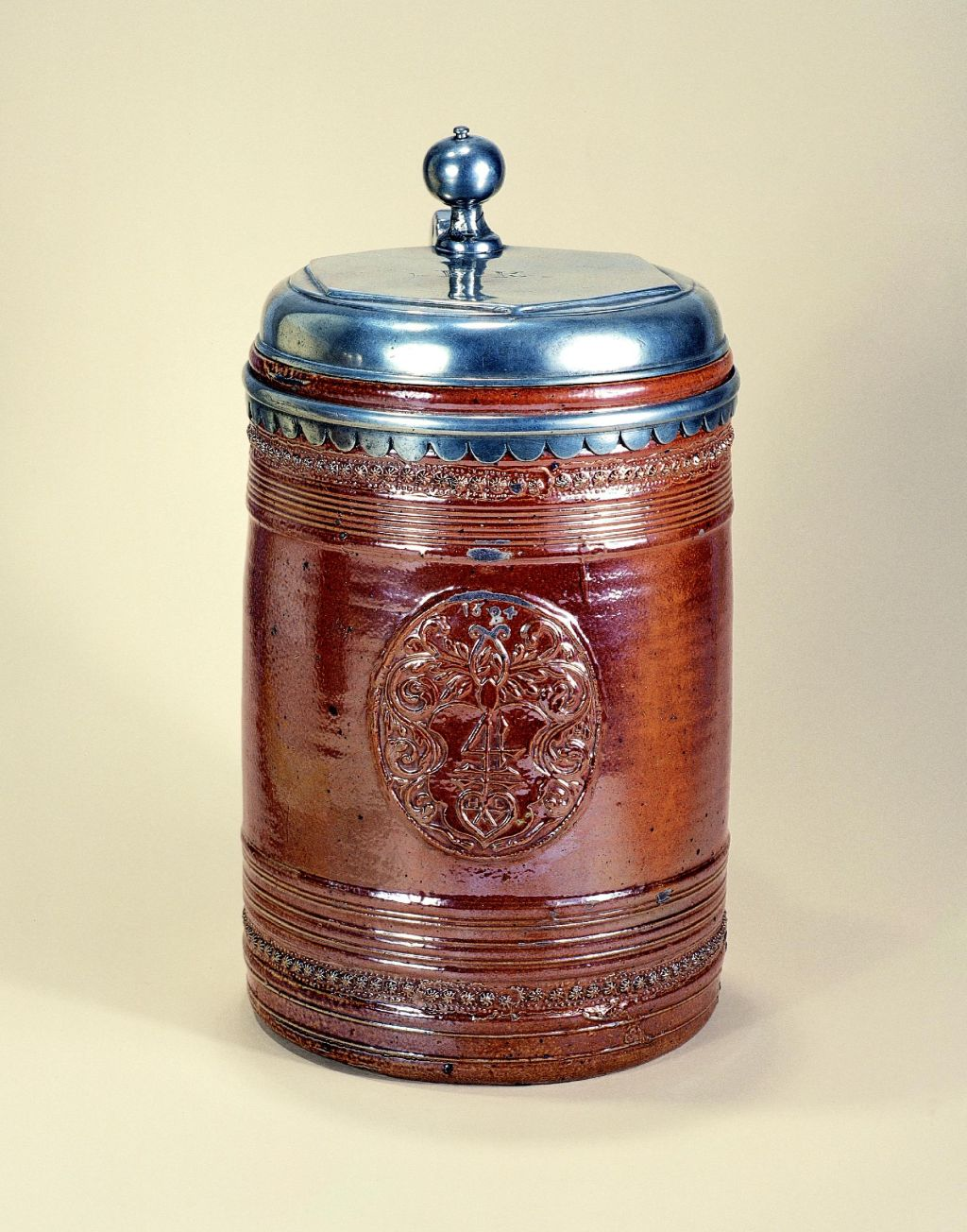 17th century saltglazed stoneware raeren-tankard-1694-datiert