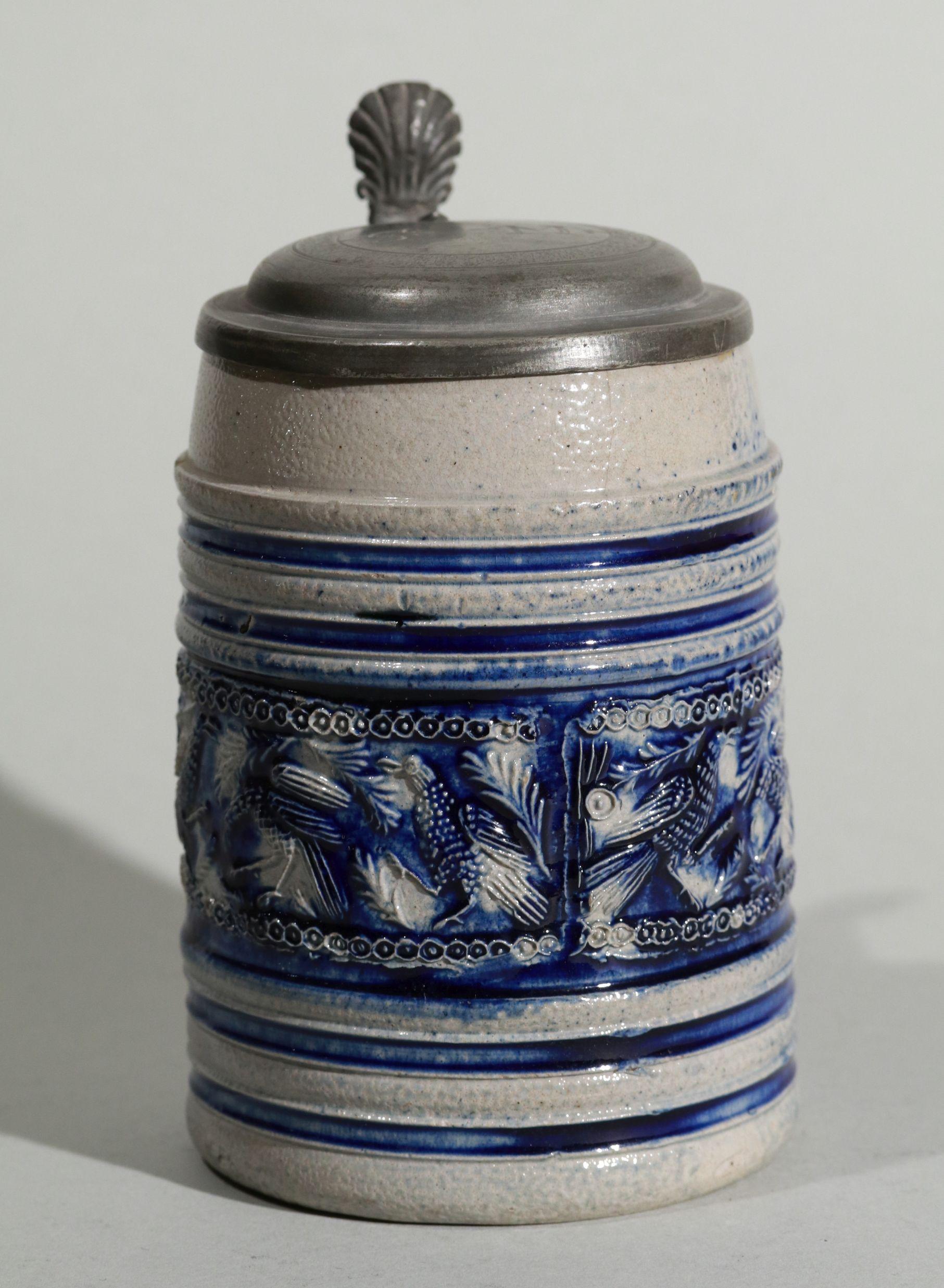 kleiner-westerwald-westerwälder-walzenkrug-um-1700- applied relief blue salt glazed stoneware tankard