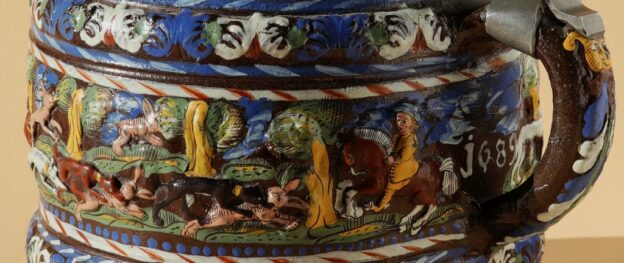 Detail 17th century Creussen saltglazed stoneware tankard with hunting scenes